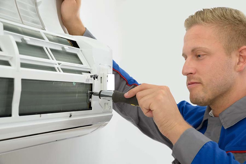 Technician Repairing Air Conditioner, Do I really need an AC tune-up